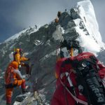 Unidentified mountaineers walk past the Hillary Step while pushing for the summit of Everest on May 19, 2009, as they climb the south face from Nepal. (STR/AFP/Getty Images)